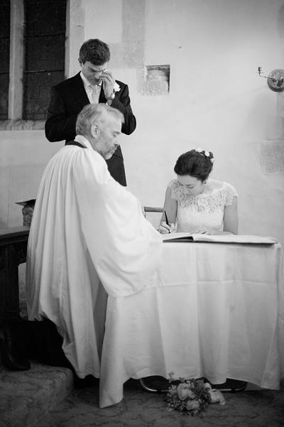 emotional groom sign register