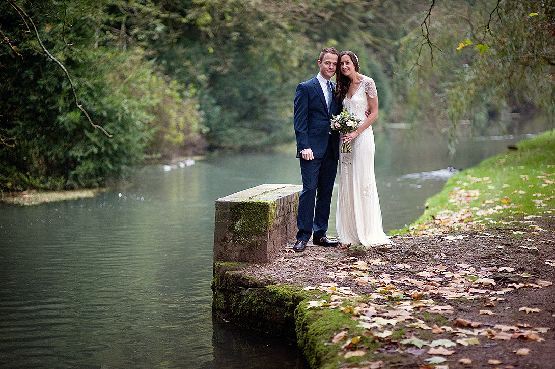 bride and groom by a river